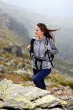 Woman hiker climbing Royalty Free Stock Image