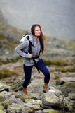 Woman hiker climbing Stock Photo