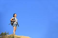 Woman hiker climbing mountain Stock Image