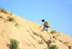 Woman hiker climbing mountain  Stock Images