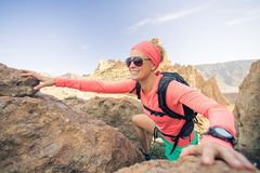 Woman hiker climbing mountains, weekend adventures Royalty Free Stock Photo