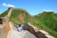 woman hiker with cross arms on Great Wall stock photography