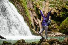 Woman hiker crossing the river Royalty Free Stock Photography