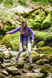 Woman hiker crossing the river Royalty Free Stock Image