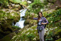 Woman hiker crossing the river Royalty Free Stock Images