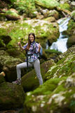 Woman hiker crossing the river Stock Photo