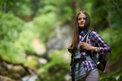 Woman hiker crossing the river Royalty Free Stock Photo