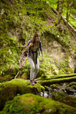 Woman hiker crossing the river Royalty Free Stock Photos