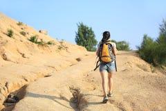 Woman hiker at desert Stock Image