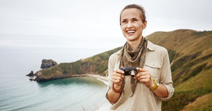 Woman hiker with digital camera looking into distance Stock Images