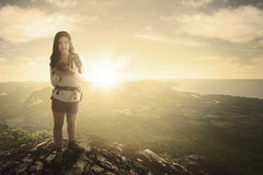 Woman hiker and digital camera at sunrise Royalty Free Stock Photo