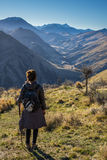 Woman hiker enjoy the View from Moonlight Track in Queenstown Stock Image