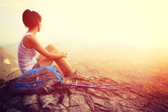 Woman hiker enjoy the view at mountain peak cliff Stock Photo
