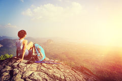 Woman hiker enjoy the view at mountain peak cliff Royalty Free Stock Images