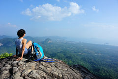 Woman hiker enjoy the view at mountain peak cliff Stock Photography