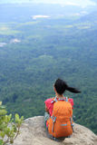 Woman hiker enjoy the view on mountain top rock Stock Images