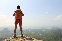 Woman hiker enjoy the view on mountain top rock Stock Photography