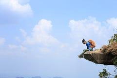 Woman hiker enjoy the view on mountain top rock Royalty Free Stock Photos