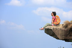 Woman hiker enjoy the view on mountain top rock Stock Image