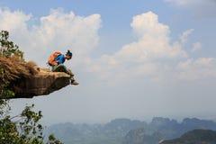 Woman hiker enjoy the view on mountain top rock. Successful woman hiker enjoy the view on mountain top rock Stock Photos