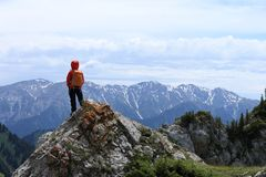 Woman hiker enjoy the view on mountain top rock. Successful woman hiker enjoy the view on mountain top rock Stock Image