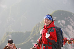 Woman hiker excited mountain peak Stock Photos