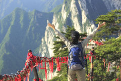 Woman hiker excited mountain peak Stock Image