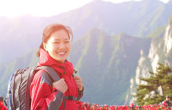 Woman hiker excited mountain peak Royalty Free Stock Photography