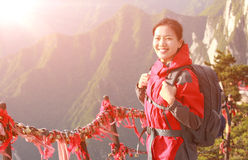 Woman hiker excited mountain peak Stock Photo