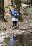 A Woman Hiker by a Forest Creek Royalty Free Stock Photos