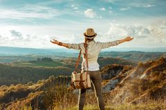 Woman hiker in front of scenery of summer Tuscany rejoicing royalty free stock photography