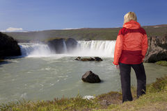 Woman Hiker At Godafoss Waterfall, Iceland Stock Photo