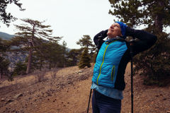 Woman hiker with hands behind  head Royalty Free Stock Photos