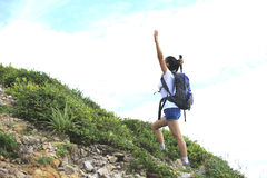 Woman hiker happy mountain peak Royalty Free Stock Image