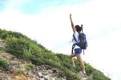 Woman hiker happy mountain peak Royalty Free Stock Image