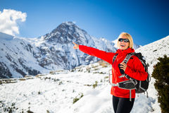 Woman hiker happy walking in Himalaya Mountains, Nepal Royalty Free Stock Images