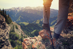 Woman hiker hiking on mountain peak cliff. Successful woman hiker hiking on mountain peak cliff stock images
