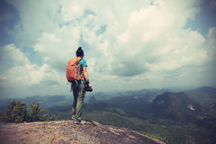 Woman hiker hiking on mountain peak. Successful woman hiker hiking on mountain peak stock photos