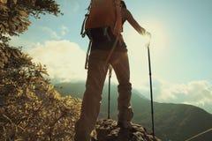 Woman hiker hiking on mountain peak. Successful young woman hiker hiking on mountain peak Royalty Free Stock Photography