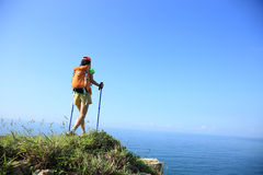 Woman hiker hiking on seaside mountain Royalty Free Stock Image