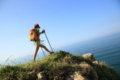 Woman hiker hiking on seaside mountain Royalty Free Stock Photography
