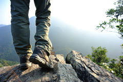 Woman hiker hiking stand on cliff Royalty Free Stock Images