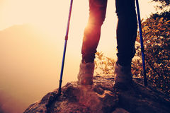 Woman hiker hiking stand on cliff Royalty Free Stock Photo