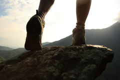 Woman hiker hiking stand on cliff Royalty Free Stock Image