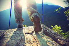Woman hiker hiking stand on cliff Stock Photo