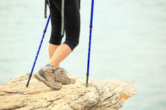 Woman hiker hiking stand on seaside rock Royalty Free Stock Photo