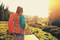Woman hiker hiking on trail in mountain Stock Photo