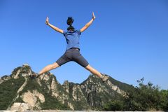 Woman hiker jumping on mountain top. Successful woman hiker jumping on mountain top Stock Photos