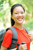 Woman hiker in jungle Stock Images