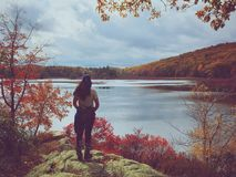 Woman hiker by a lake Royalty Free Stock Photography